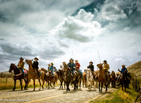 Cowboys are leading the horses at the start of the Three Forks Horse round up.