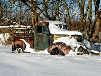 Old Dodge truck resting in the snow